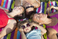 Happy family having fun outdoors on a sunny day, Stock Photo