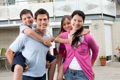 Happy family having fun outdoors at their home Royalty Free Stock Photos