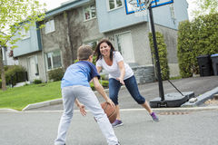 Happy family having fun outside with a basketball. Stock Images
