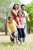 Happy family having fun in the park Stock Images