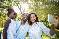 Happy family having fun Stock Photos