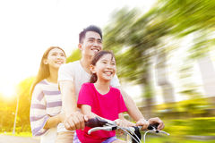 Happy  family having fun in park with bicycle Stock Photos