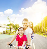 Happy  family having fun in park with bicycle Stock Photography