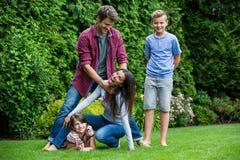Happy family having fun in park Royalty Free Stock Photo
