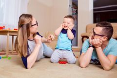 Happy family having fun playing on the floor in room.  Stock Image