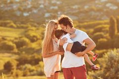 Happy family having fun playing in nature. royalty free stock images