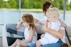 Happy family having fun on a sailboat Royalty Free Stock Photos
