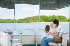 Happy family having fun on a sailboat Stock Photo