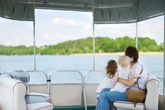 Happy family having fun on a sailboat stock photo