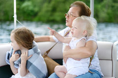 Happy family having fun on a sailboat Royalty Free Stock Photos
