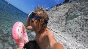 Happy family having fun on sea beach in summer vacation.