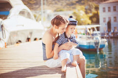 Happy Family having fun by the sea boats and yachts Royalty Free Stock Images
