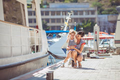 Happy Family having fun by the sea boats and yachts Royalty Free Stock Photo