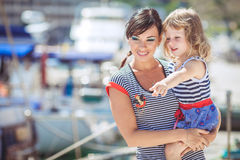 Happy Family having fun by the sea boats and yachts Royalty Free Stock Image