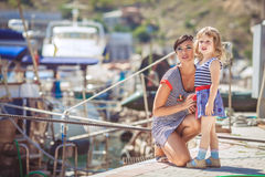Happy Family having fun by the sea boats and yachts Royalty Free Stock Photo