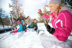 Family having fun - ski and snow time. Happy family having fun - ski and snow time royalty free stock image