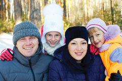 Happy family having fun snowy forest Royalty Free Stock Photos