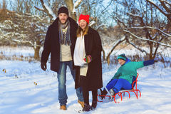Happy family having fun snowy woodland outdoor Royalty Free Stock Images