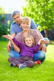 Happy family having fun in summer garden Stock Images