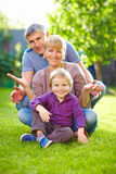 Happy family having fun in summer garden Royalty Free Stock Image