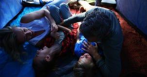 Family having fun in tent 4k. Happy family having fun in tent 4k stock footage