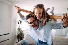 Happy family having fun time at home. Happy family having fun time together at home Royalty Free Stock Photography