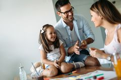 Happy family having fun time at home. Happy family having fun time together at home Royalty Free Stock Photo