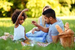 Happy family having fun time on picnic. Happy family having fun time together on picnic Stock Photo
