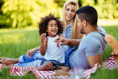 Happy family having fun time on picnic. Happy family having fun time together on picnic Royalty Free Stock Photos