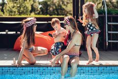 Happy family having fun time at the pool side royalty free stock photo
