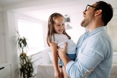 Happy family having fun time at home. Happy family having fun time together at home royalty free stock image