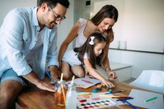 Happy family having fun time at home. Happy family having fun time together at home stock images