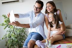 Happy family having fun time at home. Happy family having fun time together at home stock photography