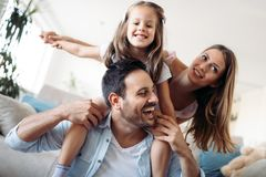 Happy family having fun time at home. Happy family having fun time together at home Stock Photo
