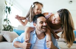 Happy family having fun time at home stock photography