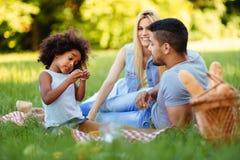 Happy family having fun time on picnic Stock Image