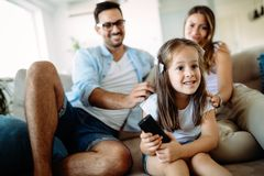 Happy family having fun time at home. Happy family having fun time watching tv at home Royalty Free Stock Photo