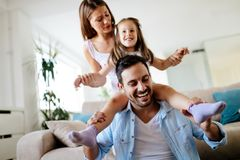 Happy family having fun times at home. Together Royalty Free Stock Photos