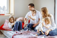 Happy family having fun together at home in bedroom. stock photography