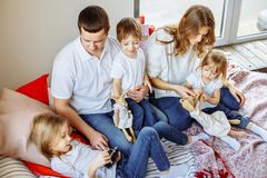 Happy family having fun together at home in bedroom royalty free stock images