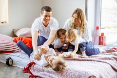 Happy family having fun together at home in bedroom. stock photos