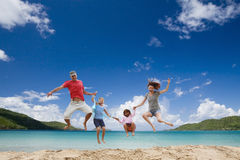 Happy family having fun at tropical beach. royalty free stock images