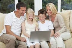 Happy Family Having Fun Using A Computer At Home Stock Photos