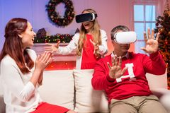 Family in vr goggles on christmas. Happy family having fun in vr goggles on christmas stock photos