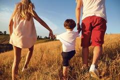 Happy family having fun walking in nature. royalty free stock photos