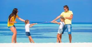 Happy family having fun on white beach Royalty Free Stock Photos