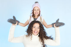Happy family having fun at winter time Stock Image