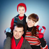 Happy family having fun at winter time Stock Images