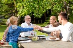 Happy family having holiday dinner outdoors Stock Photo