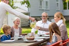 Happy family having holiday dinner outdoors Royalty Free Stock Photos